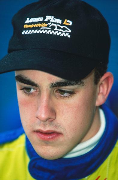 1999 Formula 1 Testing. Jerez, Spain. 13th - 17th December 1999. Fernando Alonso, Minardi M01, portrait. World - Gavin Lawrence/LAT Photographic. Ref: 35mm Colour Transparency.