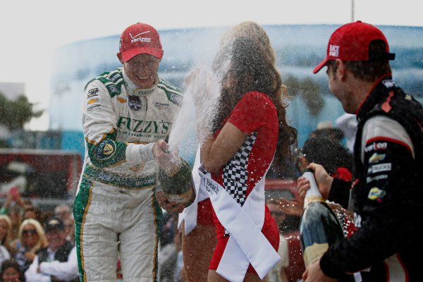 11-13 April, 2014, Long Beach, California USA Mike Conway, Carlos Munoz and Will Power celebrate on the podium with champagne ©2014, Phillip Abbott LAT Photo USA