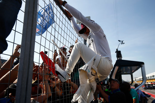 Circuit Gilles Villeneuve, Montreal, Canada. Sunday 11 June 2017. Lewis Hamilton, Mercedes AMG, 1st Position, celebrates with fans. World Copyright: Andrew Hone/LAT Images ref: Digital Image _ONZ6842