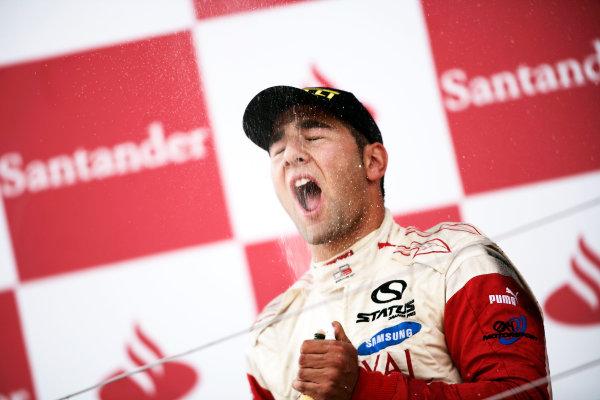 Round 4.Silverstone, England. 11th July 2010. Sunday Race. Daniel Morad, (CAN, Status Grand Prix) celebrates victory on the podium.Portrait. World Copyright: Drew Gibson/GP3 Media Service.  Digital Image _Y8P1390