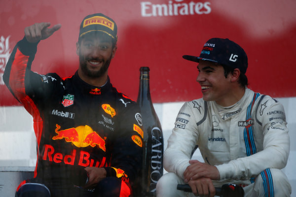 Baku City Circuit, Baku, Azerbaijan. Sunday 25 June 2017. Daniel Ricciardo, Red Bull Racing, 1st Position, and Lance Stroll, Williams Martini Racing, 3rd Position, on the podium. World Copyright: Andrew Hone/LAT Images ref: Digital Image _ONY9169