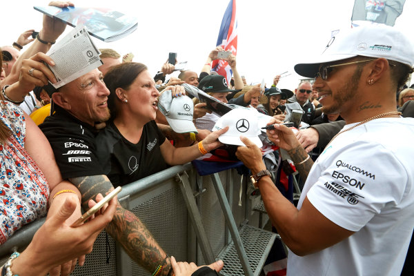 Silverstone, Northamptonshire, UK.  Sunday 16 July 2017. Lewis Hamilton, Mercedes AMG, signs autographs for fans. World Copyright: Steve Etherington/LAT Images  ref: Digital Image SNE10655