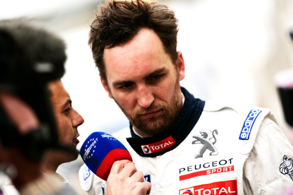 Circuit de La Sarthe, Le Mans, France. 6th - 13th June 2010.Franck Montagny, Team Peugeot Total, No 2 Peugeot 908 HDi FAP gives an interview after retiring from the lead. Portrait. World Copyright: Drew Gibson/LAT PhotographicDigital Image _Y2Z3221