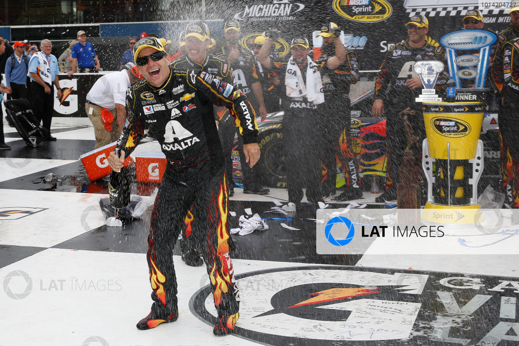 15-17 August, 2014, Brooklyn, Michigan USA Winner Jeff Gordon in Victory Lane with champagne ©2014, Michael L. Levitt LAT Photo USA