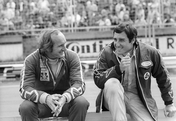 (L to R): fourteenth placed Mike Hailwood (GBR) talks with his Surtees team mate Carlos Pace (BRA), who finished in fourth position. German Grand Prix, Rd 11, Nurburgring, Germany, 5 August 1973.