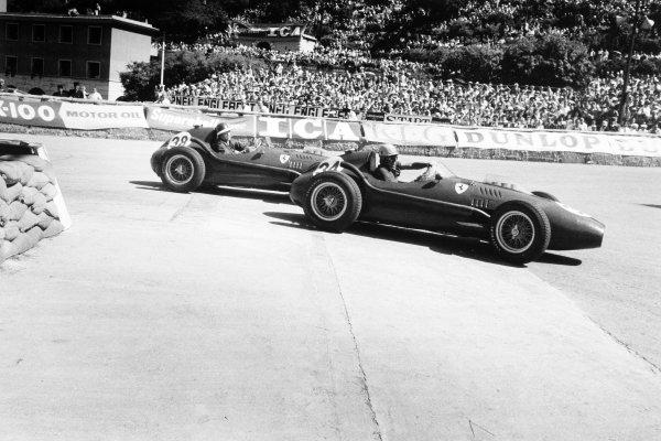 1958 Monaco Grand Prix.Monte Carlo, Monaco. 18 May 1958.Luigi Musso, Ferrari Dino 246, 2nd position, leads Mike Hawthorn, Ferrari Dino 246, retired, action.World Copyright: LAT PhotographicRef: Autosport b&w print