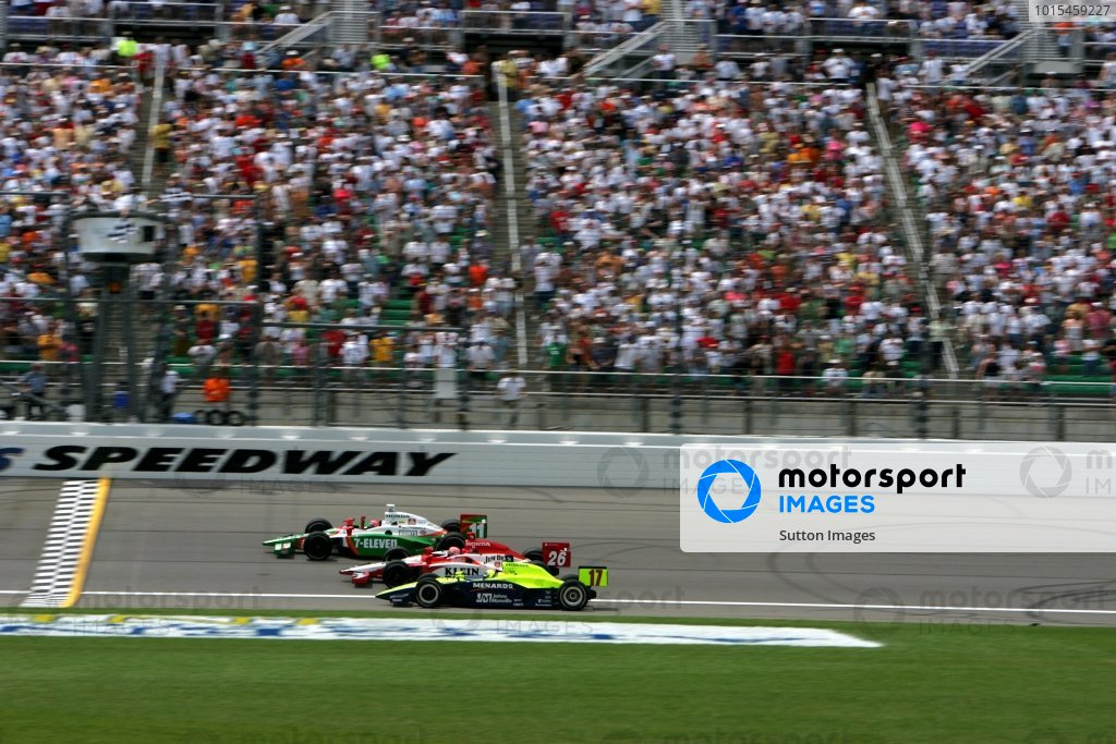 First to third place finishers: Tony Kanaan (BRA), Andretti Green Racing Dallara Honda, Dan Wheldon (GBR), Andretti Green Racing Dallara Honda, and Vitor Meira (BRA), Rahal Letterman Racing Panoz Honda, take the checkered flag at the Argent Mortgage 300. It was the sixth closest finish in IRL history.