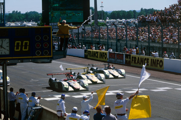Le Mans, France. 17th - 18th June 2000.Emanuele Pirro leads the three Audi R8s cross the line in order, action.World Copyright: Rick Dole/ LAT Photographic.Ref:  Colour Transparency.