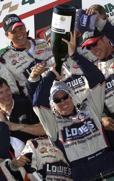 Rookie Jimmie Johnson (USA) LoweÕs Chevrolet celebrates his second victory of the season.NASCAR Winston Cup Series, MBNA Platinum 400, Dover International Speedway, 2 June 2002. DIGITAL IMAGE