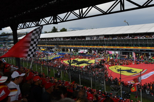 Giant ferrari flag and fans invade the track