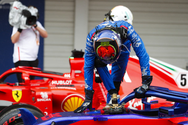 Brendon Hartley, Scuderia Toro Rosso, climbs out of his car in Parc Ferme after Qualifying
