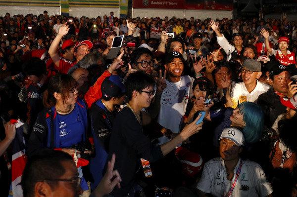 Lewis Hamilton, Mercedes AMG F1, meets a large crowd of fans.