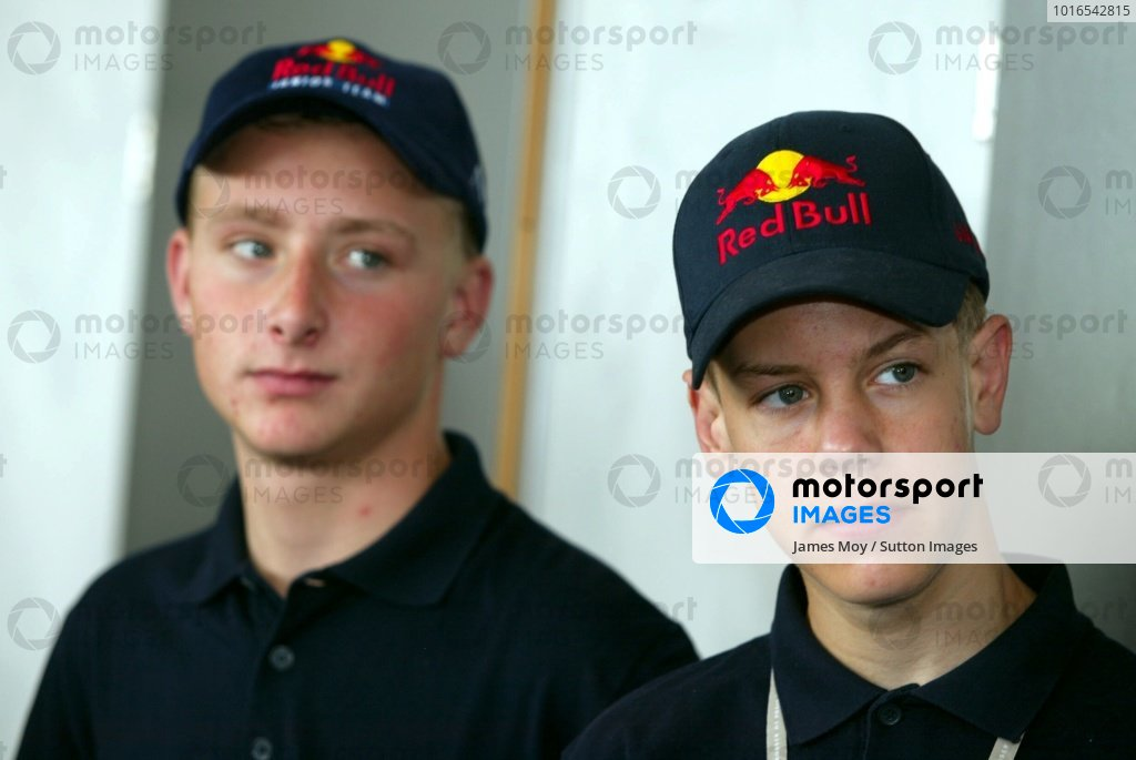 L-R: Reinhard Kofler (AUT), Sebastian Vettel (GER), Red Bull Junior team at the Austrian Grand Prix. Austrian Grand Prix, A1-Ring, 10 May 2002. DIGITAL IMAGE