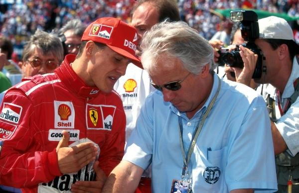 Michael Schumacher(GER) with Charlie Whiting of the FIA, right