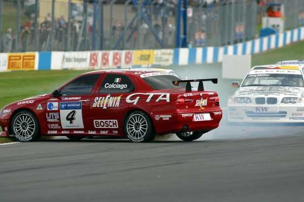 Roberto Colciago (ITA) Alfa Romeo spins while challenging Dirk Muller (GER) BMW Team Deutschland for the lead into the first corner in race 1.