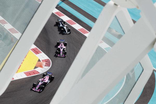 Esteban Ocon, Racing Point Force India VJM11, leads Sergio Perez, Racing Point Force India VJM11, and Valtteri Bottas, Mercedes AMG F1 W09 EQ Power+