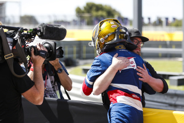 Robert Shwartzman (RUS) PREMA Racing, is congratulated by a Finnish representative of SMP in parc ferme