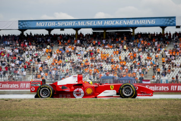 Mick Schumacher drives the Ferrari F2004 driven to championship victory by his father Michael Schumacher in the 2004 F1 season