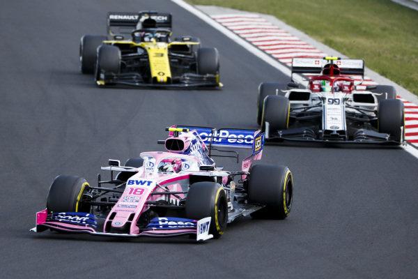 Lance Stroll, Racing Point RP19, leads Antonio Giovinazzi, Alfa Romeo Racing C38, and Daniel Ricciardo, Renault R.S.19