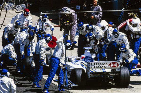 Rubens Barrichello, Stewart SF3 Ford, makes a pit stop.