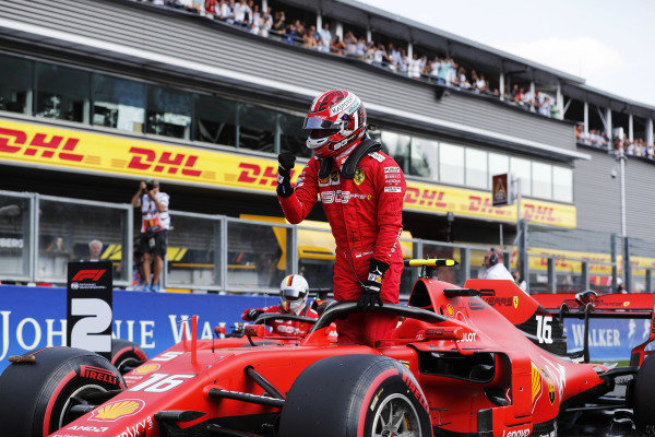 Charles Leclerc, Ferrari, celebrates pole position on the grid