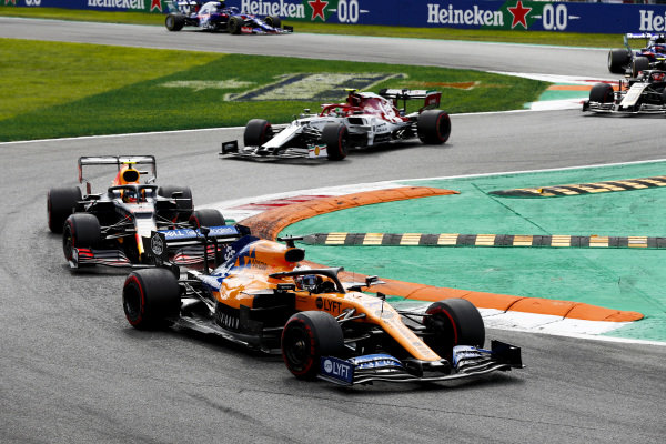 Carlos Sainz Jr., McLaren MCL34, leads Alexander Albon, Red Bull RB15, and Antonio Giovinazzi, Alfa Romeo Racing C38