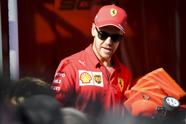 Sebastian Vettel, Ferrari during the Sky TV remote control car challenge in the paddock