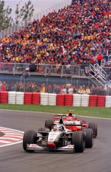 1998 Canadian Grand Prix.Montreal, Quebec, Canada. 5-7 June 1998.David Coulthard (McLaren MP4/13 Mercedes-Benz) leads Michael Schumacher (Ferrari F300).World Copyright - LAT Photographic