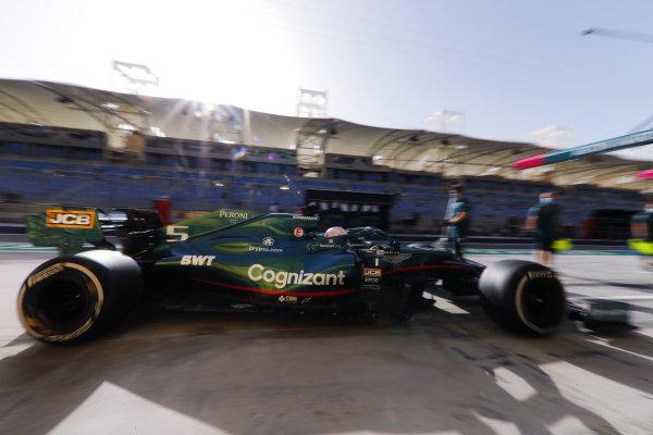 Sebastian Vettel, Aston Martin AMR21, arrives at the Aston Martin garage
