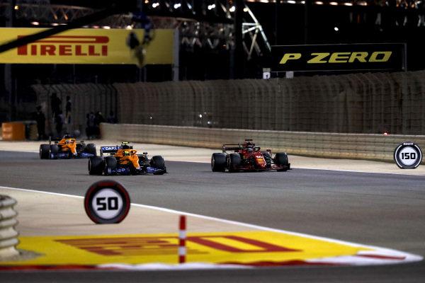 Charles Leclerc, Ferrari SF21, leads Lando Norris, McLaren MCL35M, and Daniel Ricciardo, McLaren MCL35M