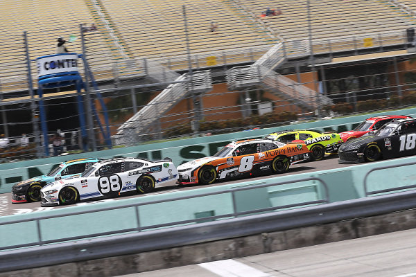 Chase Briscoe, Stewart-Haas Racing Ford Ford Performance Racing School, Noah Gragson, JR Motorsports Chevrolet PUBG MOBILE, lead the field on the overtime restart, Copyright: Chris Graythen/Getty Images.