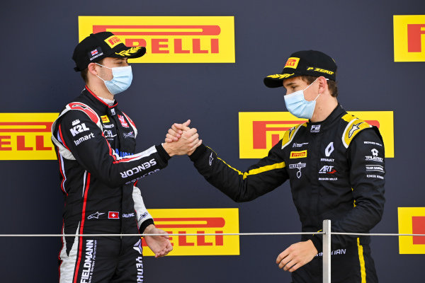 Louis Deletraz (CHE, CHAROUZ RACING SYSTEM) and Christian Lundgaard (DNK, ART GRAND PRIX) celebrate on the podium