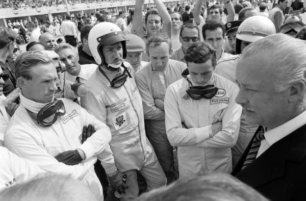 Mike Spence, Jo Bonnier, John Surtees and Jim Clark are amongst the drivers' at the race briefing.