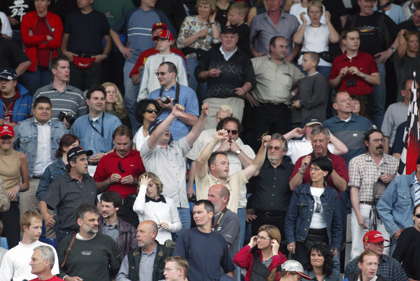 2002 Austrian Grand Prix - RaceA-1 Ring, Zeltweg, Austria. 12th May 2002The fans react to the farcical ending to the Grand Prix by jeering as they see Ferrari team orders put Michael Schumacher across the line ahead of a dominant Rubens BarrichelloWorld Copyright: Pic Steve Etherington/LATref: Digital Image Only