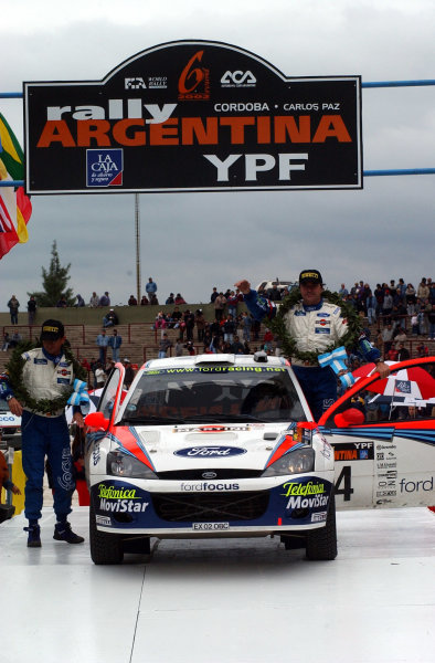 World Rally Championship, Rally of Argentina, May 16-19, 2002.Carlos Sainz on the podium in Cordoba unknowingly having won!.Photo: Ralph Hardwick/LAT