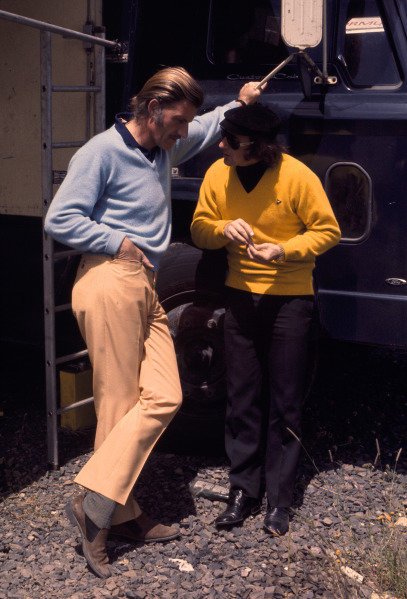 1970 French Grand Prix.Clermont-Ferrand, France.3-5 July 1970.Graham Hill (Walker Racing) chats with Jackie Stewart (Tyrrell).Ref-70 FRA 119.World Copyright - LAT Photographic