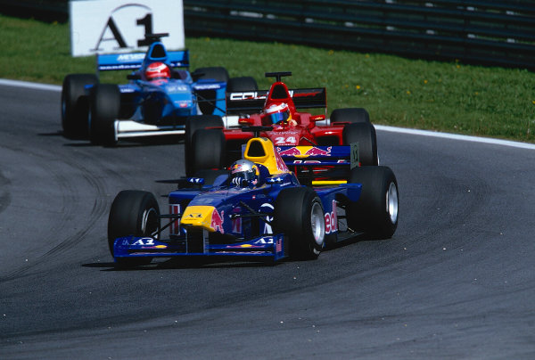 2002 F3000 ChampionshipA1-Ring, Austria. 11th May 2002.Patrick Friessacher (Red Bull Jnr), leads Enrico Toccacelo (Coloni F3000), action.World Copyright: Clive Rose/LAT Photographicref: 35mm Image A06
