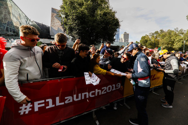 Lance Stroll, Racing Point and Carlos Sainz Jr, McLaren sign autographs for fans at the Federation Square event