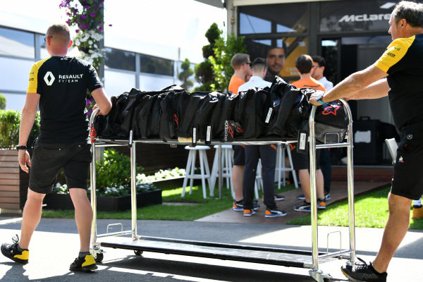 Renault personnel wheel equipment through the paddock