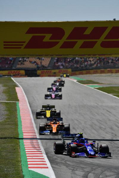 Alexander Albon, Toro Rosso STR14, leads Carlos Sainz Jr., McLaren MCL34, Daniel Ricciardo, Renault R.S.19, and Sergio Perez, Racing Point RP19