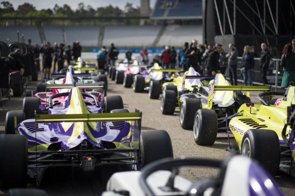 The cars line up in the pits