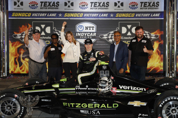 Josef Newgarden, Team Penske Chevrolet celebrates with  DXC guests in victory lane