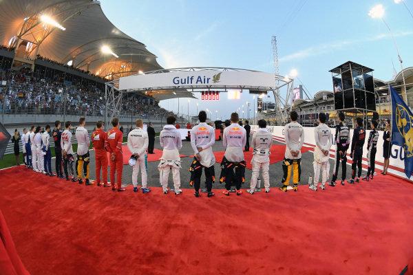 Drivers observe the National Anthem on the grid at Formula One World Championship, Rd3, Bahrain Grand Prix Race, Bahrain International Circuit, Sakhir, Bahrain, Sunday 16 April 2017. BEST IMAGE