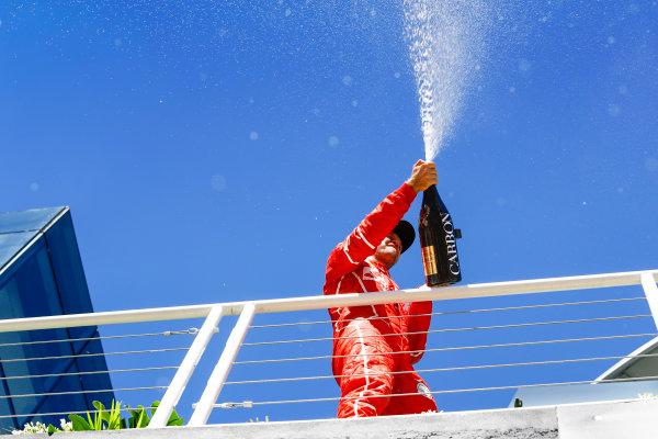 Interlagos, Sao Paulo, Brazil. Sunday 12 November 2017. Sebastian Vettel, Ferrari, 1st Position, sprays the champagne on the podium. World Copyright: Steven Tee/LAT Images  ref: Digital Image _O3I0889