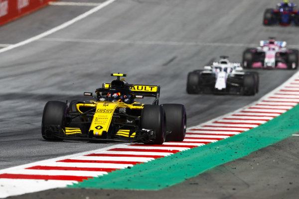 Carlos Sainz Jr., Renault Sport F1 Team R.S. 18, leads Lance Stroll, Williams FW41 Mercedes, and Sergio Perez, Force India VJM11 Mercedes.