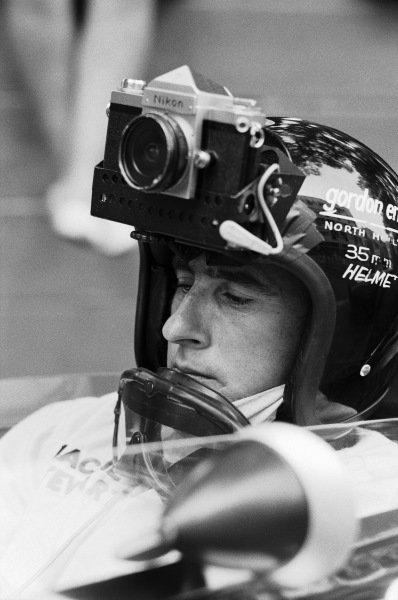 Jackie Stewart wearing an improvised helmet camera.