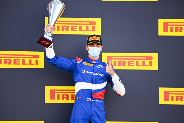Race Winner Alexander Smolvar (RUS, ART GRAND PRIX) celebrates on the odium with the trophy
