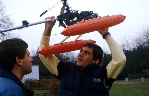 Ayrton Senna (BRA) flies his model helicopter. Formula One Drivers At Home, Esher, Surrey, England. 1985.