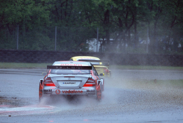 2002 DTM Championship, Zolder, Belgium. Rd 2, 4th-5th May 2002.Bernd Schneider chases the Audi of Christian Abt in the treacherous conditions of a wet Zolder track.World Copyright: Lawrence/LAT Photographic