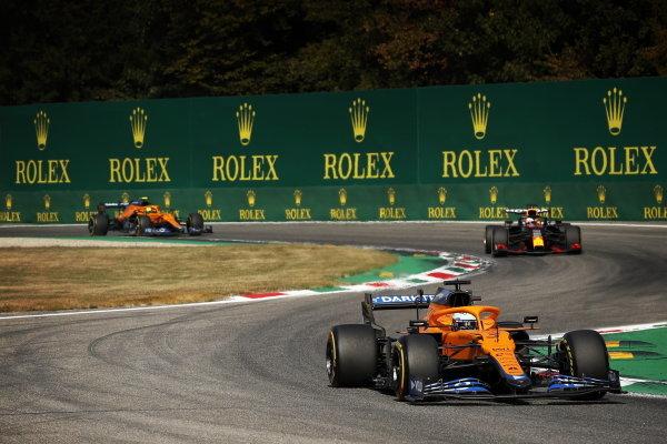 Daniel Ricciardo, McLaren MCL35M, leads Max Verstappen, Red Bull Racing RB16B, and Lando Norris, McLaren MCL35M